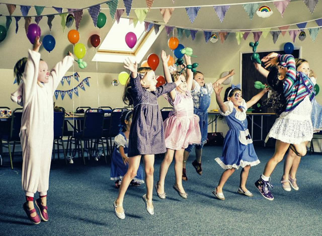 Children jumpping at party